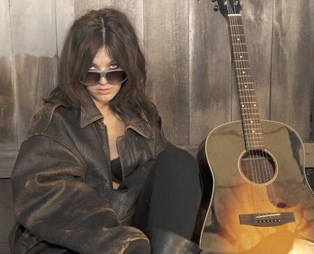 Nice portrait Image of a Woman with Guitar Stock Photo - 11089161