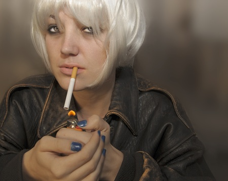 A Portrait of a Young Woman Lighting a Cigarette Stock Photo - 11088966
