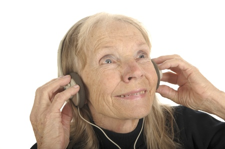 Very Cute Image Of a Senior Woman Listening To Music Stock Photo - 11088968