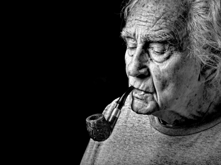 Very Nice Image of an Old man and His Pipe Stock Photo