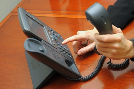 telecommunications equipment: Nice office Image Of a Worker using the phone