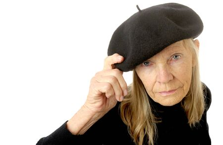very Cute Image of a senior woman In a beret Stock Photo