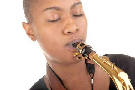 Nice Isolated image of a young woman with a saxophone Stock Photo - 11089762