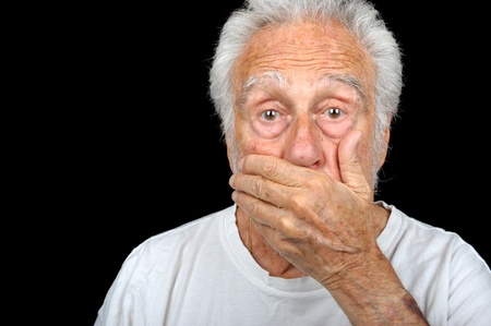 A portrait of a senior man with hand over face. Stock Photo - 11089778