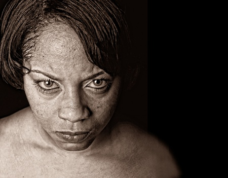aging american: Very Striking Image of a afro american woman with anger Stock Photo