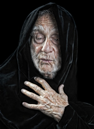 Beautiful Image Of an elderly spiritual man on Black Stock Photo