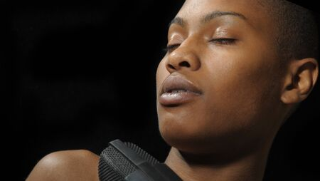 beautiful image Of a woman singer on black