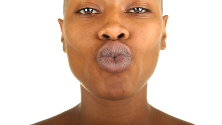 A very fun Image of a afro american woman kissing the camera photo