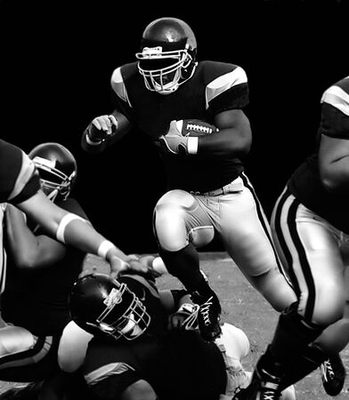 football tackle: American football fullback over the top for touchdown