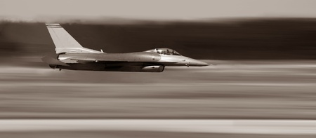 Image of a Military F-16 Jet Fighter Showing Speed