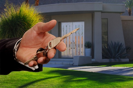 Image of a beautiful Desert home in california as real Estate salesman Hands Over Keys Standard-Bild