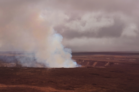 Dramatic Cloudy Image of The Kilauea Volcano On Hawaii  photo