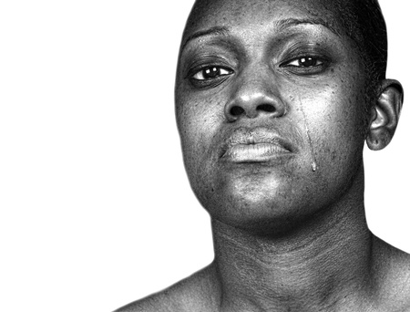 Beautiful Powerful Image of a Black woman Crying isolated on white photo