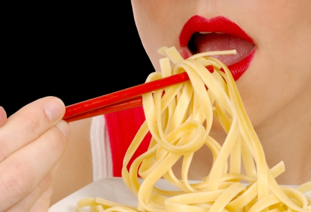 plateful: Nice Image of a woman eating pasta with chopsticks