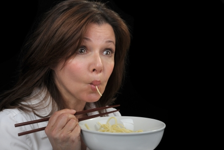 plateful: Nice Image of a woman sucking down pasta