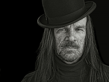 long haired: Nice Image of a Long haired Man with Vintage bowler Hat