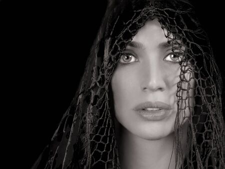 shadow: Gorgeous Middle eastern woman with shawl on Black