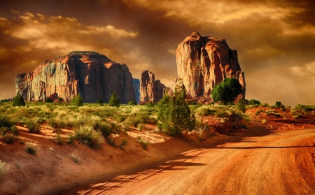 arizona sunset: Beautiful Image of a Road through monument Valley Stock Photo