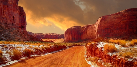 Beautiful Image of the road through monument valley in Winter photo