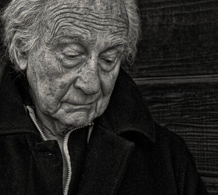 black man thinking: Outdoor Portrait of a senior man with Sadness Stock Photo