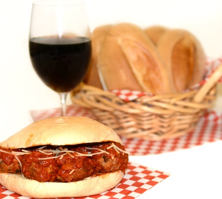 Nice Image of a delicious meetball Sandwich with bread and wine photo