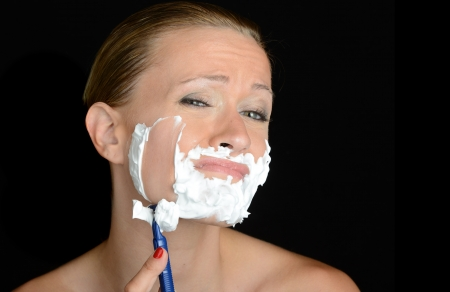 Nice humourous Image of a woman shaving photo