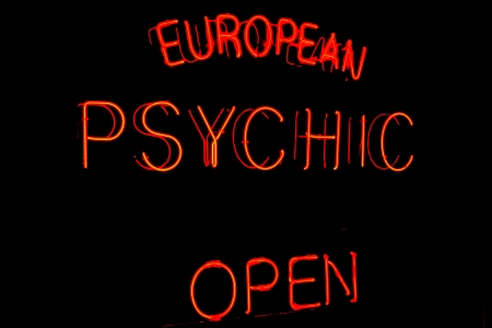 psychic: Image of a Psychic sign with neon on Black Stock Photo