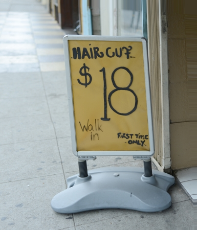 barbershop: Sign on the street for getting a haircut Stock Photo