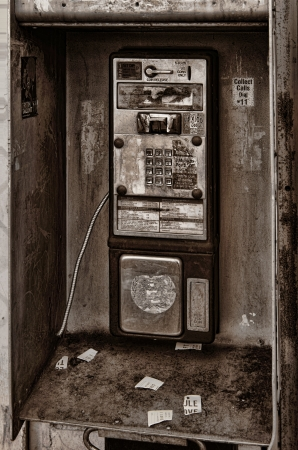 pay wall: Interesting Image of a derelict telephone booth Editorial