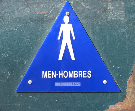 cleanly: Nice Image of a english,spanish sign to a bathroom