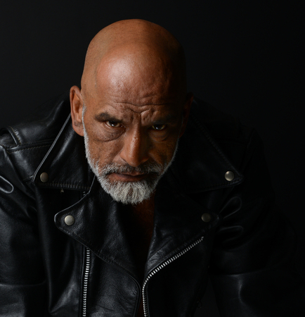 tough: Strong Image of a very Tough Man on Black Stock Photo