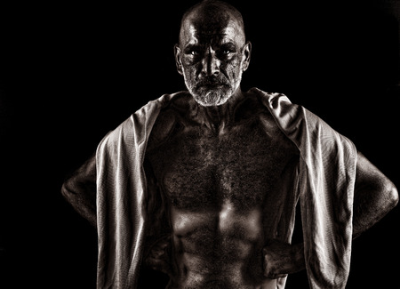 powerful man: Strong Image of a very Tough Man on Black Stock Photo