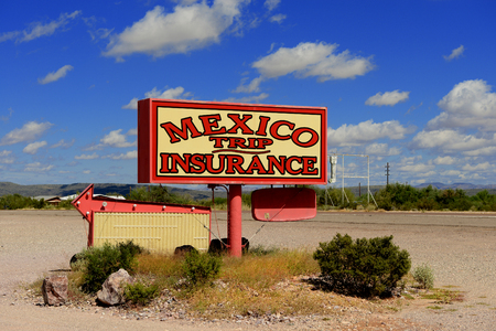 Image of a sign In New Mexico selling Insurance for travel to Mexico Editorial
