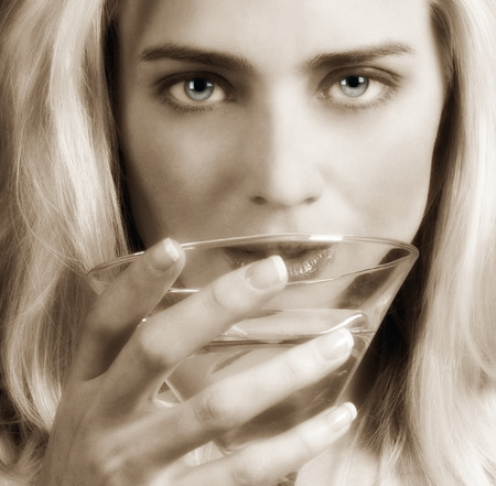erotic woman: Beautiful Blond Model with a martini in Hand