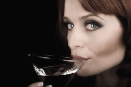 Nice image of a Woman sipping a martini on Black photo