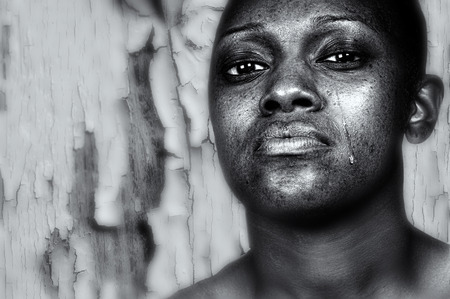 obsessed: Striking Image of a depressed afro american Woman Stock Photo