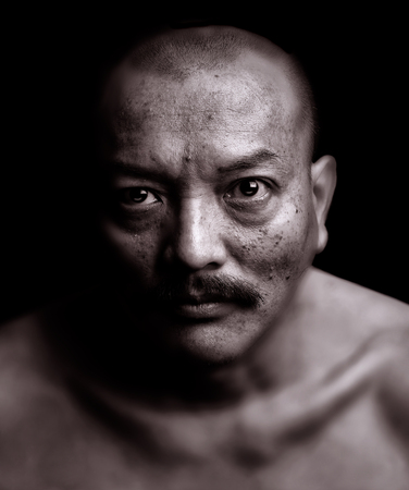 adult vietnam: Nice emotional Portrait of a vietnamese man on Black