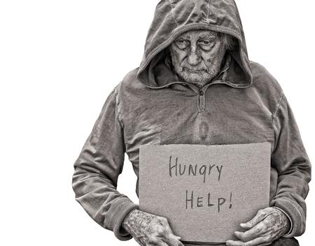 A sad Senior Homeless man isolated on white photo