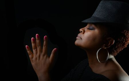 female singer: Very Nice Emotional Image of a beautiful Afro American Woman giving Thanks Stock Photo