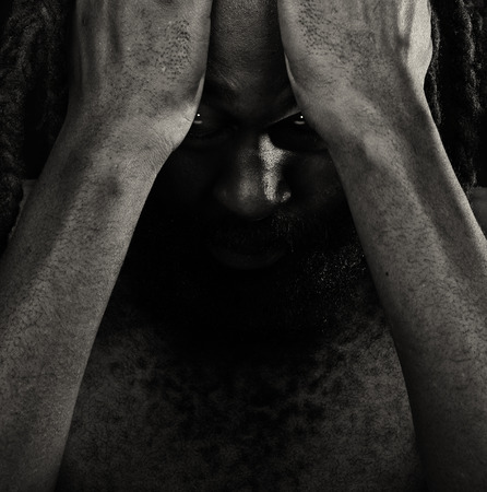 dreadlock: Very Emotional Image Of a Afro American Man with Shame Stock Photo