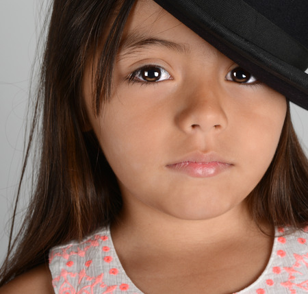 brunette girl: Nice Image of a young latino Actress with Bowler hat