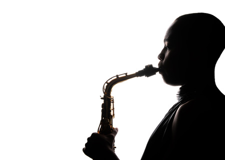 african american woman silhouette: Nice Image Of a afro American Holding and playing the saxophone