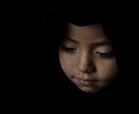 smiling face: Nice Low Key striking sensitive Image of a Young Latino Girl on Black
