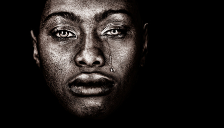 Very strong Image Of a afro American woman Crying  isolated on Black