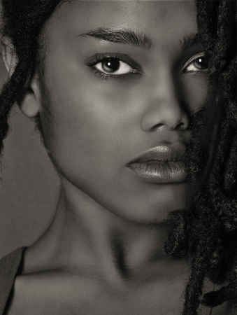 Lovely Closeup of beautiful Black woman on grey