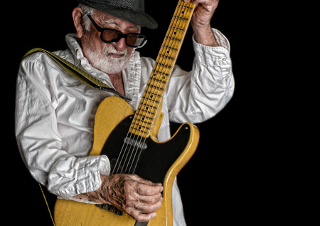 Nice active Image Of a Elderly Rock Blues guitar player during a solo