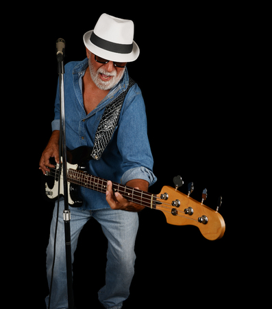 bass player: Los Angeles,California USA. july 16th 2016 A dramatic Nice studio Image Of a Senior Bass Player Stock Photo