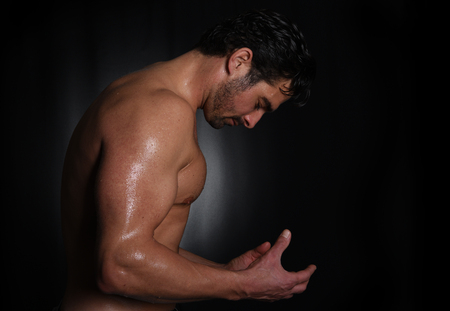 male body: very Strong Image of a Body Builder In Studio