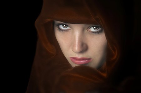 Beautiful Image of a woman In a red cape photo