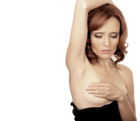 Image of a woman doing a self breast Exam photo